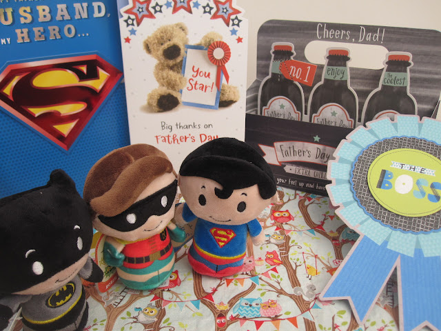 Selection of Father's Day cards, badge and small superhero soft toys