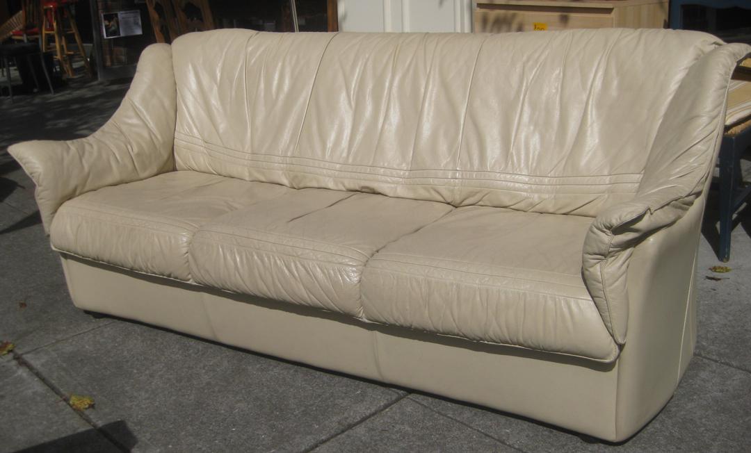 UHURU FURNITURE & COLLECTIBLES SOLD Beige Leather Sofa