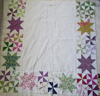 Pinwheels and Stars baby quilt sandwich
