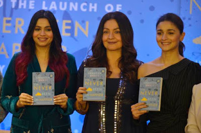 "From left to right; Shaheen Bhatt, Pooja Bhatt, and Alia Bhatt holding Shaheen's book, ""I Have Never Been (Un) Happier"""