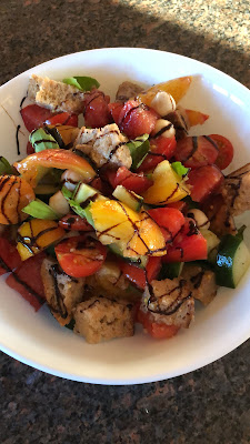 panzanella salad with red and yellow tomatoes