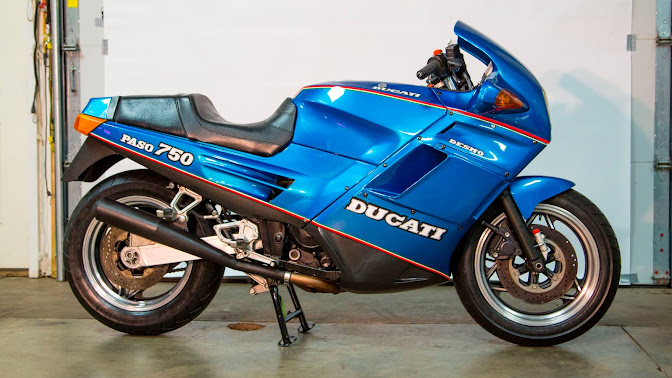 """1988 Ducati Paso 750 in metallic neon blue with 16"""" wheels - More '80s than Max Headroom appearing on Miami Vice."""