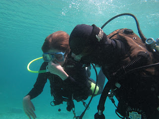 beginner diver practices equalising ears in the blue sea