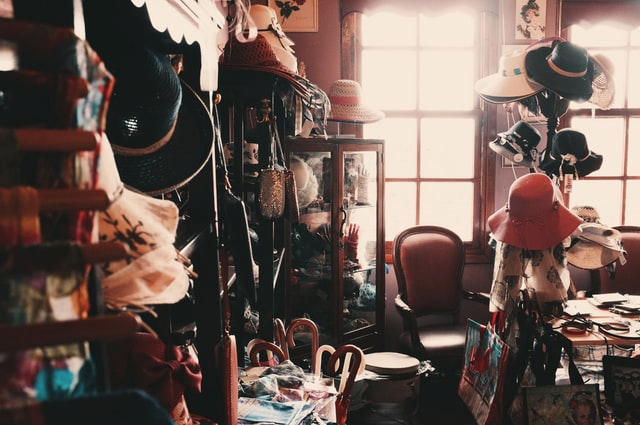 A messy room with various objects thrown around