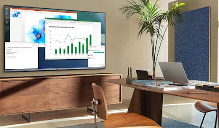 A laptop on the table projecting spreadsheets and charts onto the samsung tv