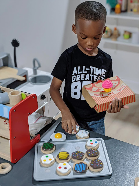 preschool boy pretending to deliver sweet treats
