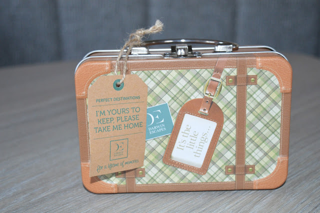 Small tin suitcase.