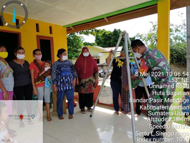 Pendampingan Posyandu Dilakukan Personel Jajaran Kodim 0208/Asahan Bersama Bersama Dengan Bidan Desa