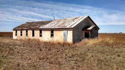 An old abandoned and dilapidated church building in Plains Texas.