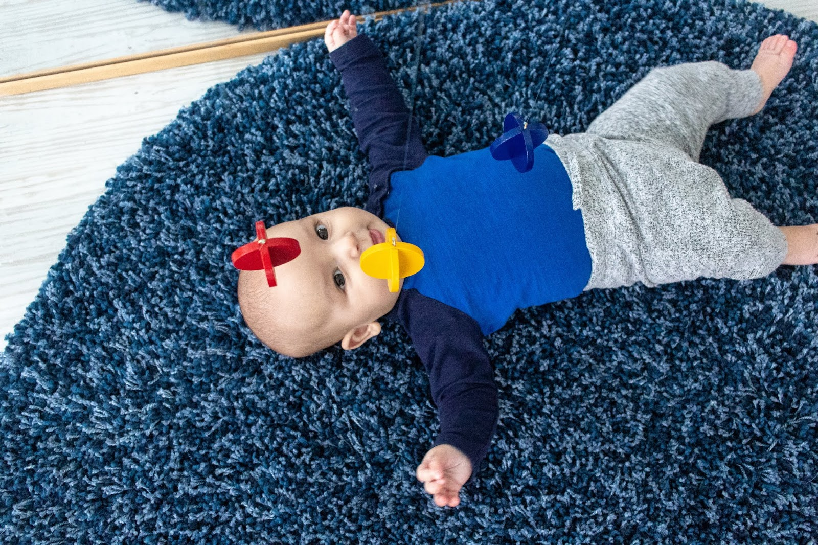 A look at Montessori friendly options for a baby that is interested in batting at toys. Some options include a primary colors mobile.