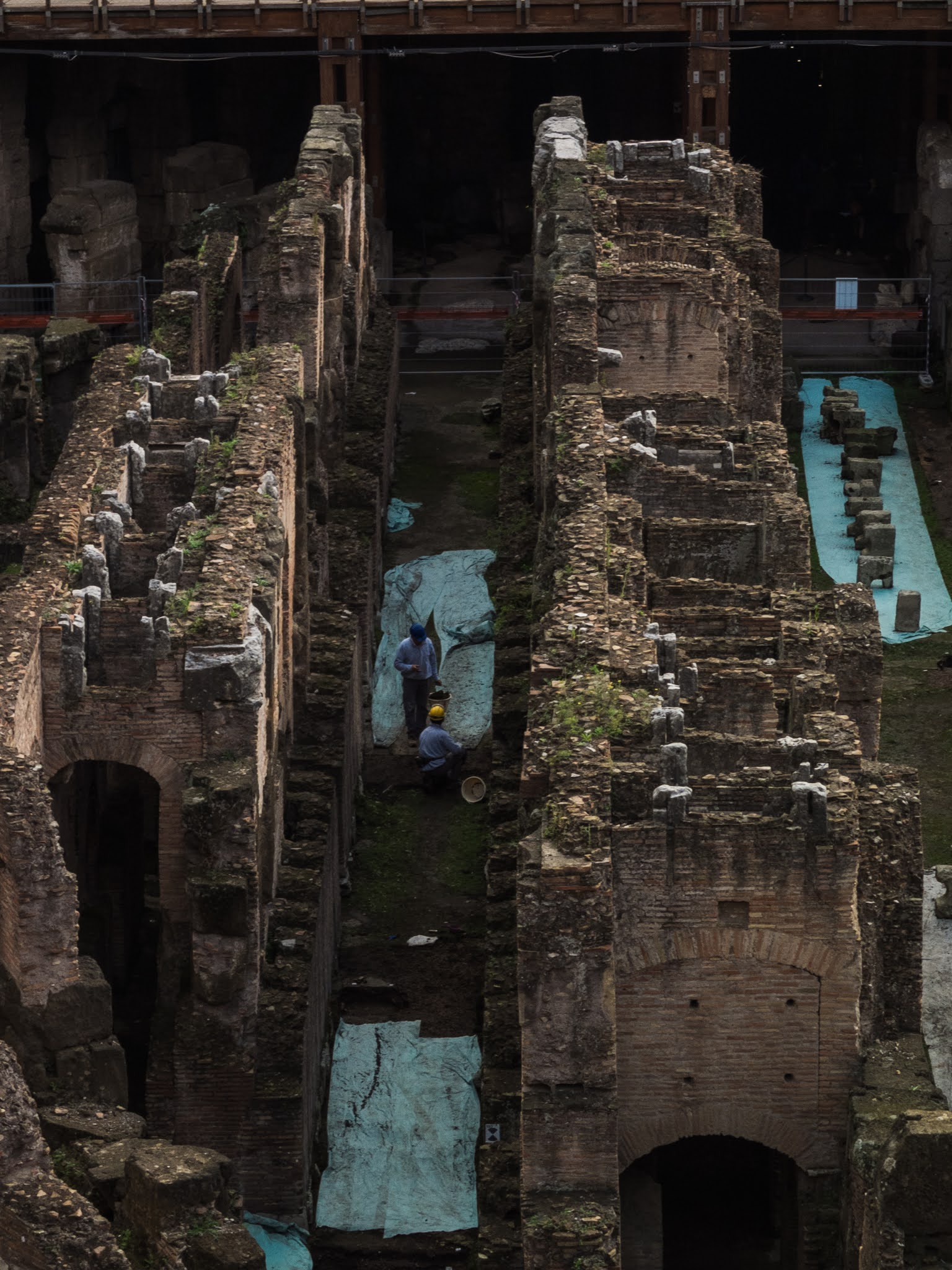 Two men excavating in the Hypogeum of the Colosseum