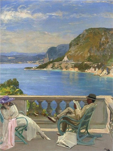 couple sitting in balcony with sea and mountain view in background