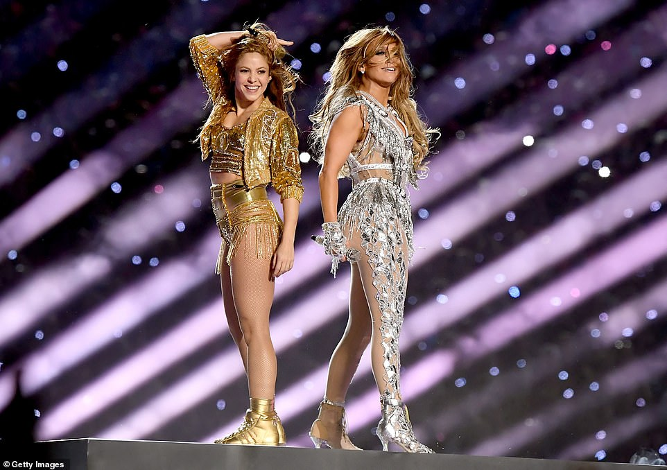 Shakira changed in a gold ensemble featuring a cropped jacket and fringed mini shorts, while Lopez donned the same outfit in silver
