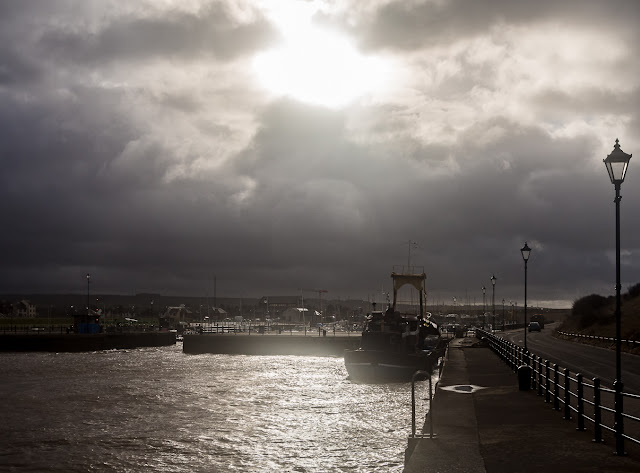 Photo of stormy skies over Maryport Basin with the marina in the distance