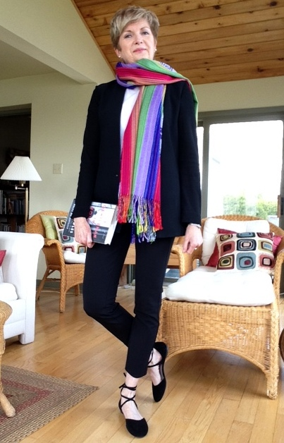 black pants and jacket, black lace-up flats, white tee and striped scarf from Peru