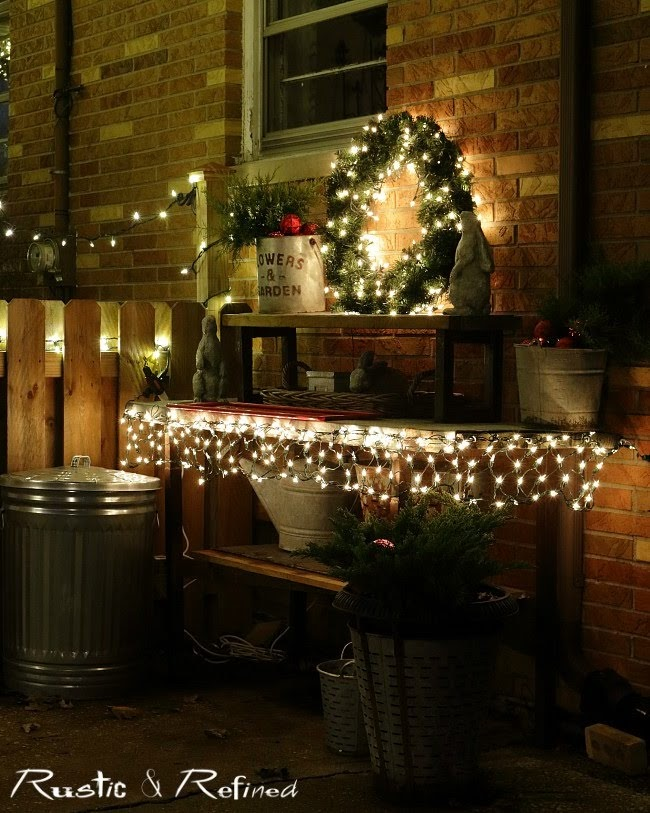 Adding Christmas decor to my potting bench for that festive holiday detail to our outdoor holiday decorations.