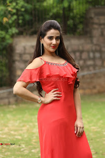 Manjusha looks super cute beautiful in Red Dress At Kurukshetram Trailer Launch ~ Exclusive