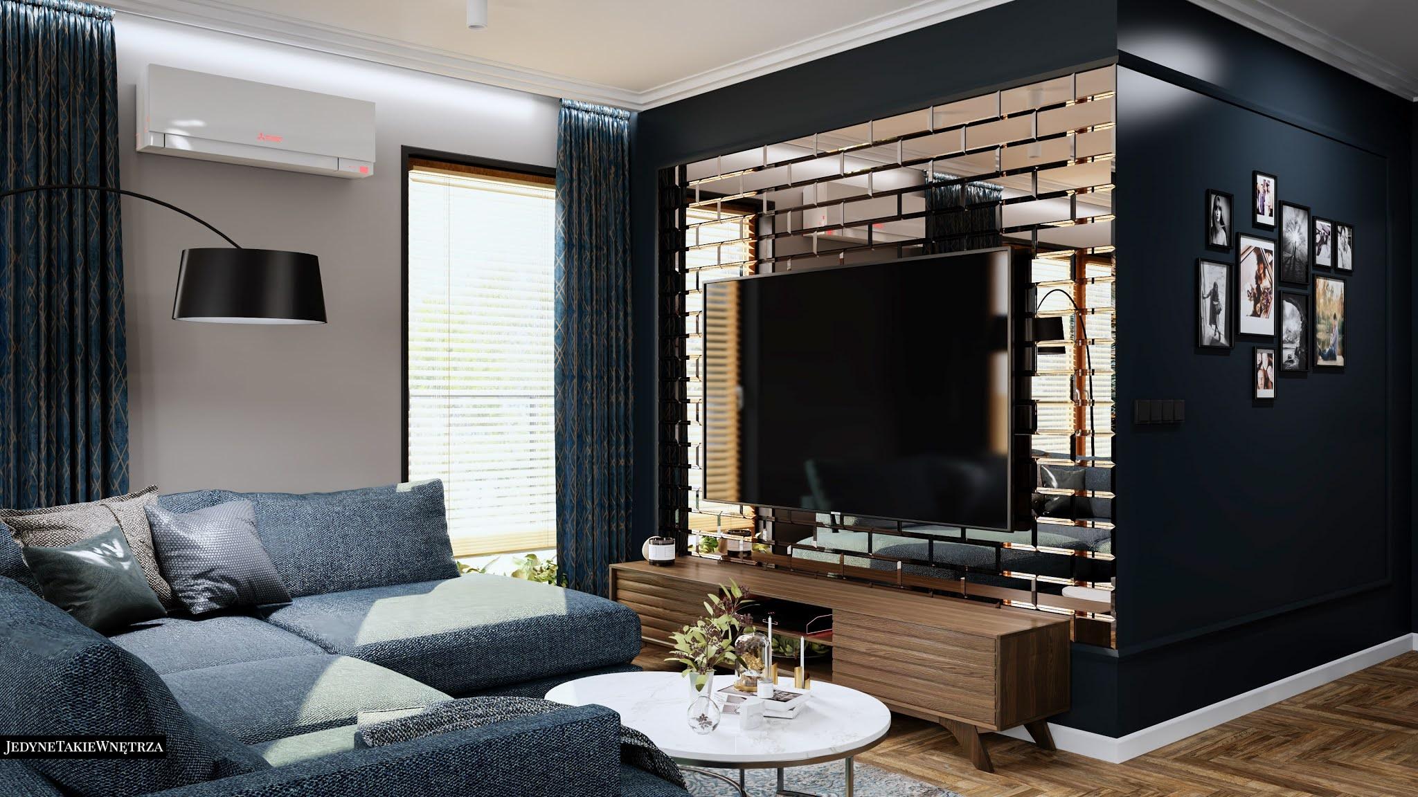 Nowoczesny salon z narożną kanapą, obok stoi marmurowy stolik kawowy. Listwy na ściance z tv, którą zrobi błyszcząca czarna cegła.