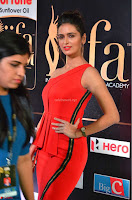 Meenakshi Dixit in Red One Shoulder Red Zipped up gown at IIFA Utsavam Award 12.JPG