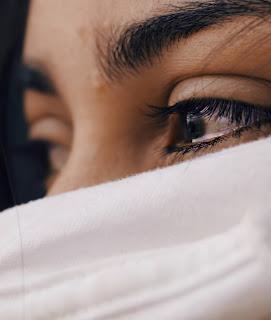a woman's sad eyes