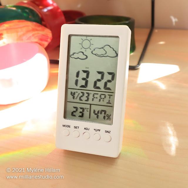 Digital barometer displaying temperature and humidity readings