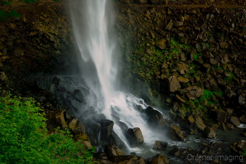 Cramer Imaging's fine art landscape photograph of a waterfall cascading down onto rocks with moss and plants in Twin Falls Idaho