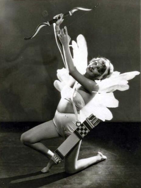 Dolores Brinkman as Cupid