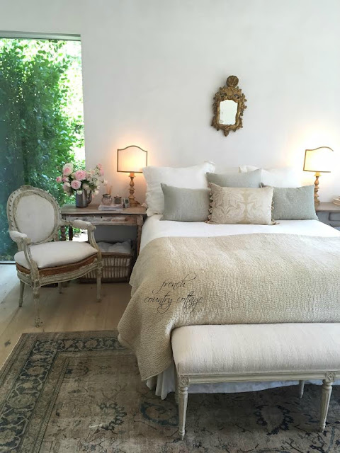 Bedroom with neutral colors and antiques