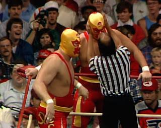 WCW / NWA Starrcade 1988 - True Gritt - Teddy Long checks over The Russian Assassins