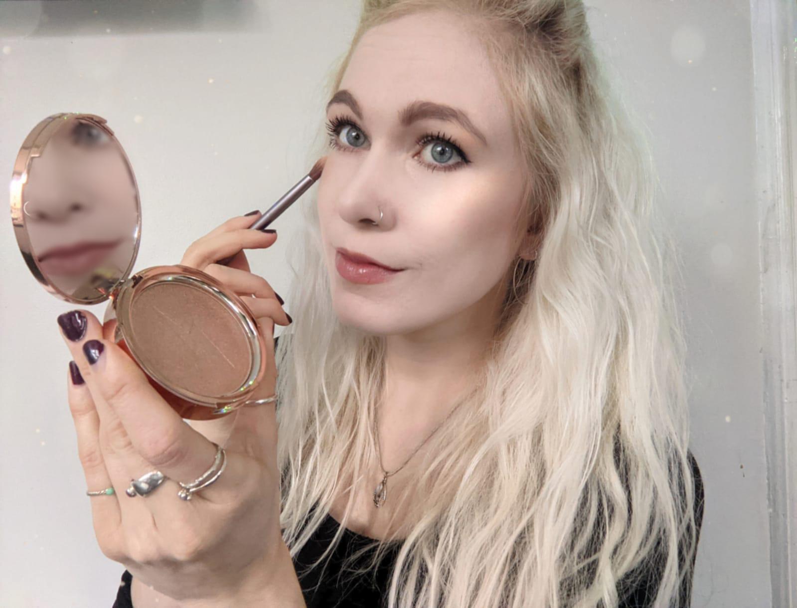 Jolie Beauty Saintly Dreaming Second Skin Highlighter on pale skin littlepackofvegans