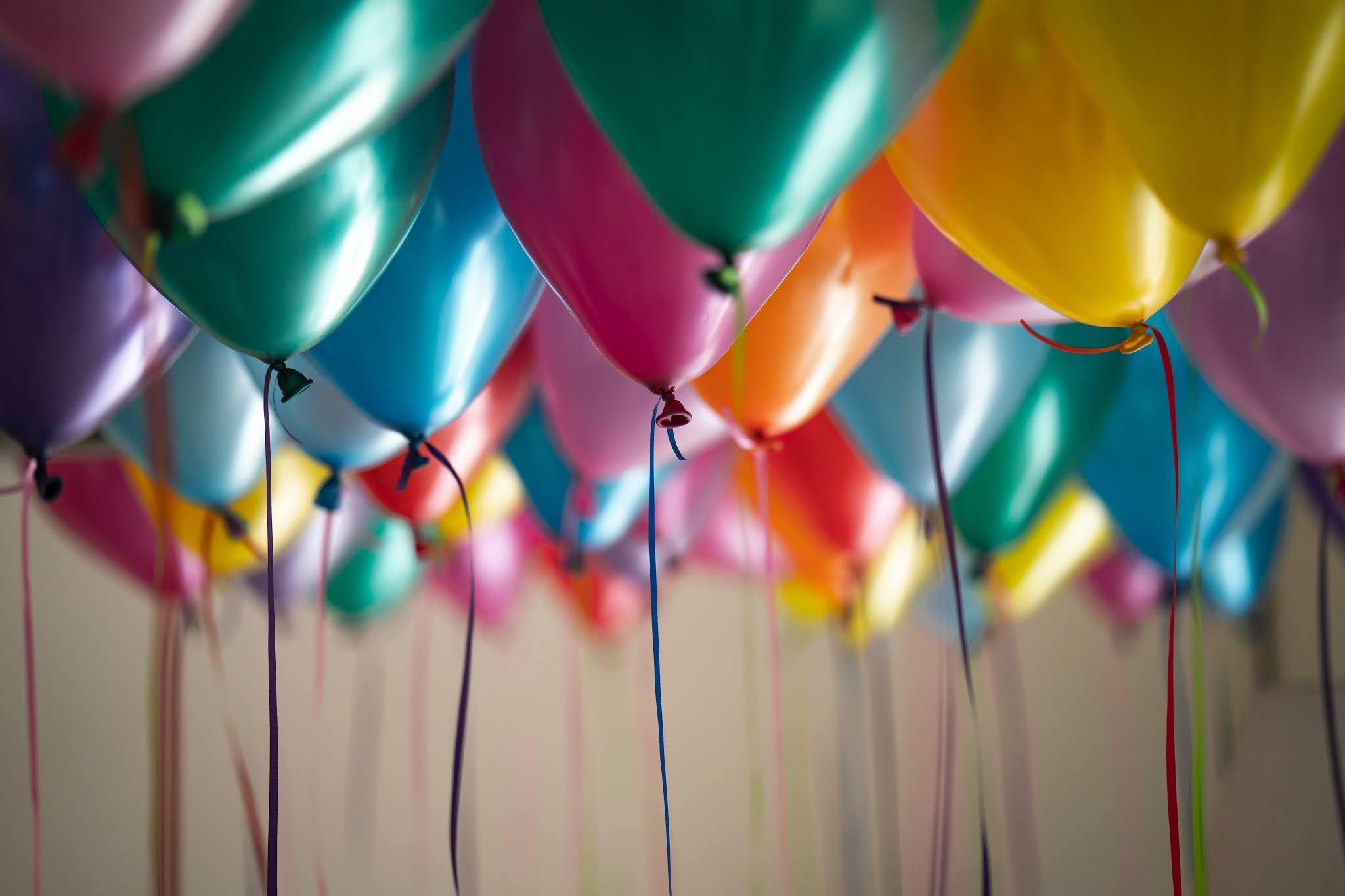 Photo by Adi Goldsteinon Unsplash Image CCO OF LOTS OF Helium balloons
