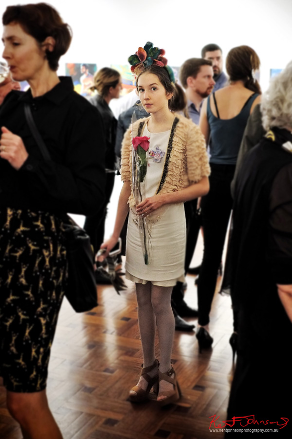 A young woman wearing a floral headpiece holding a rose for Wendy.  Street Fashion Sydney by Kent Johnson.