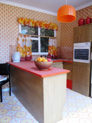 Modern dolls' house miniature 1970s-style kitchen.