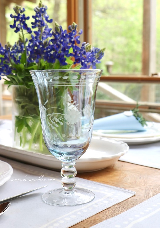 Easter Table With Bluebonnets has pale blue stemware with a floral etched design