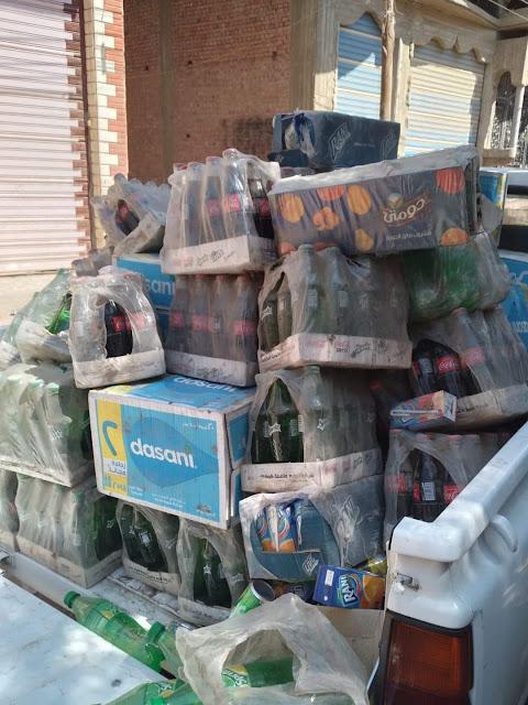 ضبط ١٤٠٠ عبوة مياه غازية وعصير راني منتهية الصلاحيه وغير صالحه للاستهلاك الادمى بمركز الفيوم
