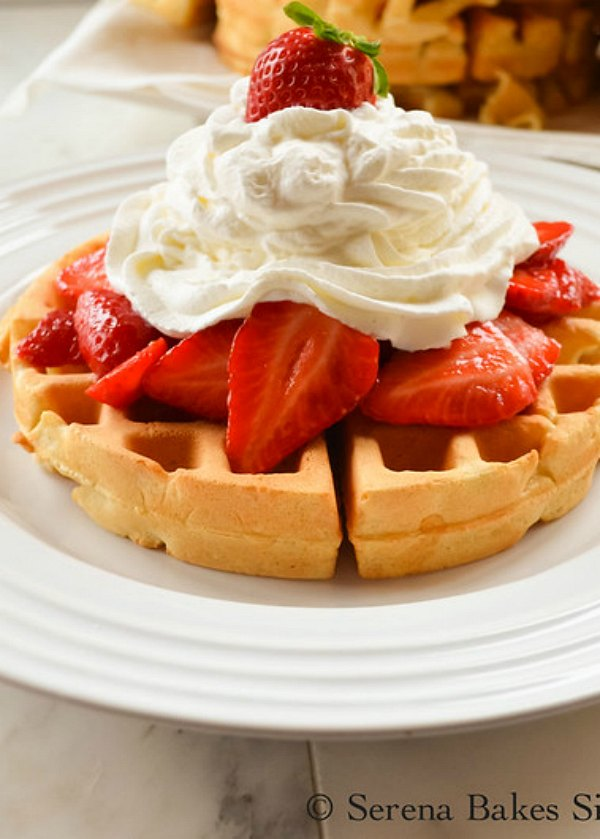Perfect Waffles topped with strawberries and whipped cream from Serena Bakes Simply From Scratch is a favorite for breakfast or brunch!