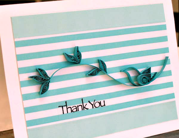quilled bird on branch card with striped background paper adhered with washi tape