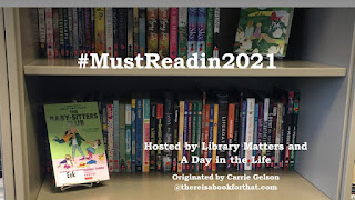Bookshelf filled with books. Babysitter's Club graphic novel on a bookstand. Words present are # Must Read in 2021 Hosted by Library Matters and A Day in the Life Originated by Carrie Gelson at There is a book for that dot com