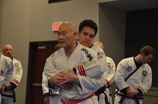 Grandmaster Bong Yul Shin practicing with Moo Sul Kwan black belts at the MSK Summer Expo