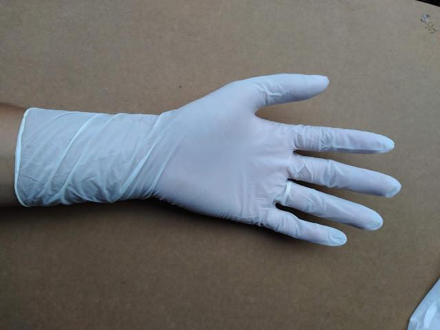 Găng tay cao su y tế nitrile 12' trước
