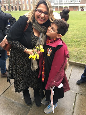 Woman and small child dressed as Harry Potter character