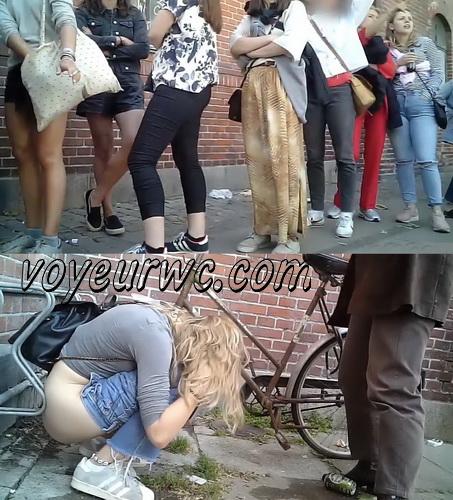 Girls peeing at a public festival voyeur (Public Piss Poster 17)