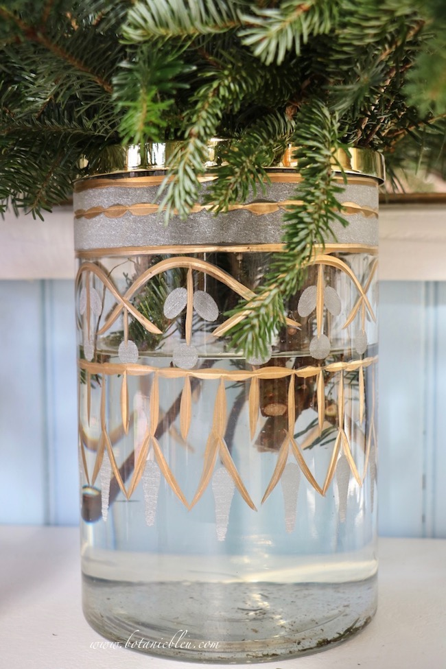 French Country Christmas Event 2019 has an arrangement glass vase with a gold etched design