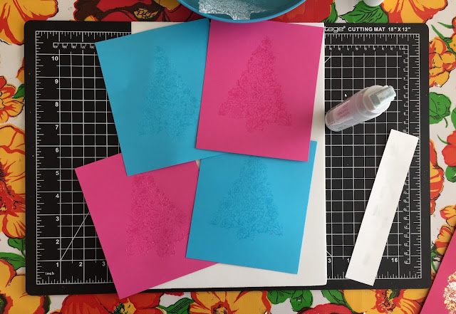 card stock freshly glue stamped with Botanical tree waiting to dry before gilding