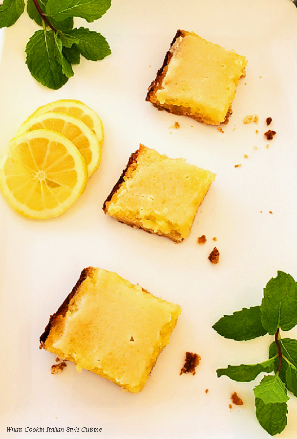 these are a lemon bars that has a pudding like filling on a shortbread cookie crust made with sour cream in the filling
