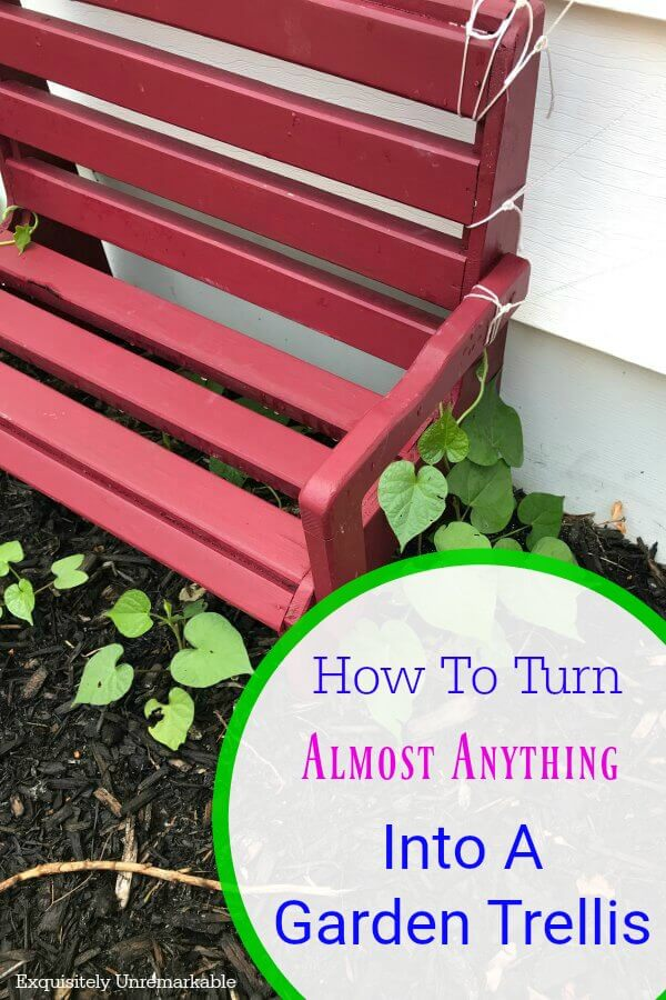 Small red bench in garden with text overlay How To Turn Anything Into A Garden Trellis