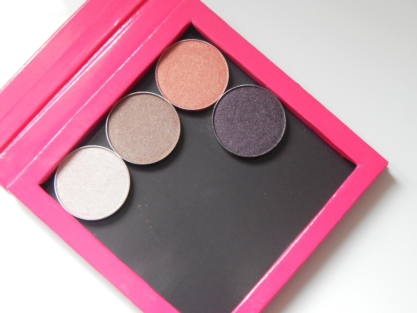 Makeup Geek Eyeshadows in Cosmopolitan, homecoming, drama queen and shimma shimma and Z palette
