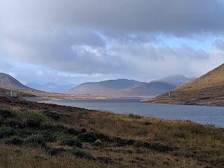 Moor, loch and distant mountains on the horizon in the Scottish highlands