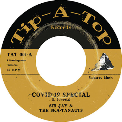 The artwork features the single's paper label with the imprint (Tip-A-Top), song title, and band name.