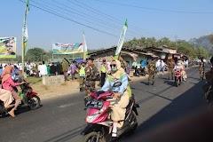 Sinergitas Banser Dan Polsek Limpung Amankan Hari Santri Di Lapangan Desa Plumbon